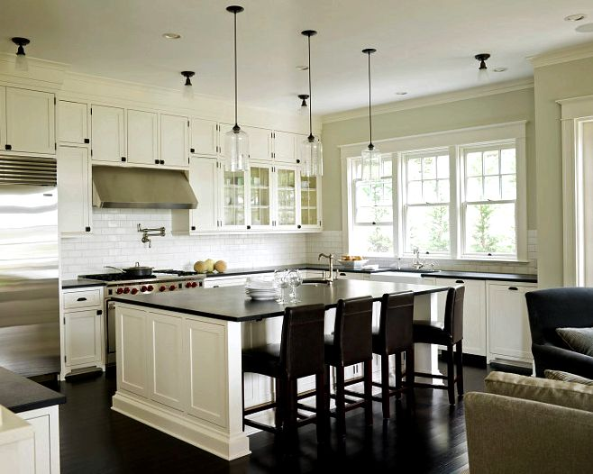 White kitchen cabinets painted benjamin Moore Cloud White, Ann sacks subway tiles backsplash, Rohl farmhouse sink, honed black granite countertop and Rohl faucet kit. off-white-kitchen-with-black-granite-countertop Susan Marinello Interiors